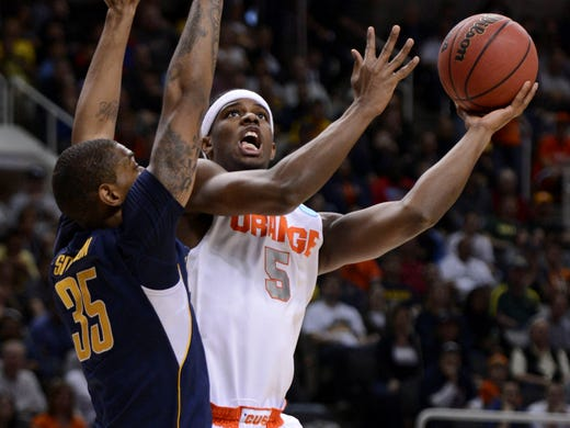 East Regional (San Jose): Syracuse Orange forward C.J. Fair shoots against California Golden Bears forward Richard Solomon during the first half during the third round at HP Pavilion. Fair led Syracuse with 18 points in the Orange's 66-60 win.