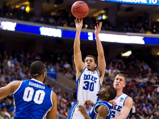 Midwest Regional (Philadelphia): Duke Blue Devils guard Seth Curry shoots a jump shot during the first half against the Creighton Bluejays at Wells Fargo Center. Curry scored 17 points with four rebounds and two steals in the 66-50 win.