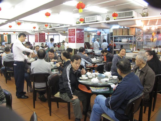 The 80-year-old Lin Heung Kui restaurant in Sheung Wan, Hong Kong's oldest Chinese district. This popular working-class eatery specializes in dim sum served from carts rolled in between tables.