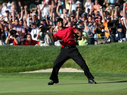 Tiger Woods has won 79 times on the PGA Tour, three short of the all-time record held by Sam Snead. Here, on June 15, 2008, Woods makes a birdie on the 18th green to force an 18-hole playoff with Rocco Mediate at the U.S. Open at Torrey Pines. Woods won that playoff the next day for his 65th victory and 14th major. Now, take a look back at all 79 of Woods' victories.