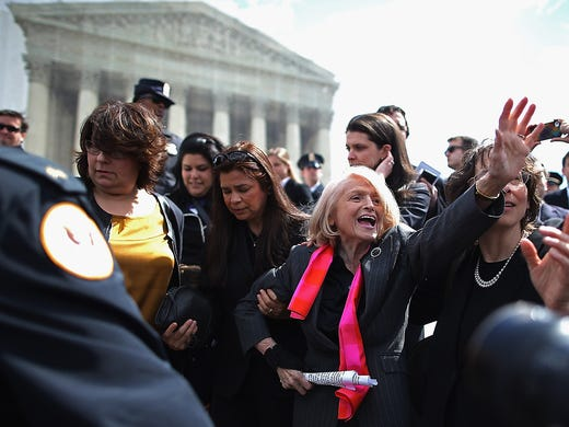 Edith Windsor, center, is mobbed by journalists and supporters as she leaves the Supreme Court on March 27 in Washington, D.C. Windsor, 83, a lesbian who was ordered to pay a federal inheritance tax of $363,000 following the death of her partner of more than 40 years in 2009, is challenging the constitutionality of Section 3 of the Defense of Marriage Act.