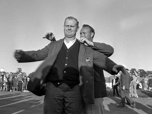 Jack Nicklaus' first Masters title came in 1963. Arnold Palmer, who won in 1962, helps him on with the green jacket. The 2013th Masters is the 50 anniversary of his first win