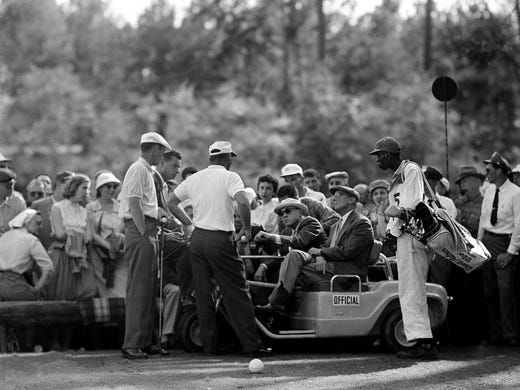 Arnold Palmer, center, argues a rules point at the 12th hole after his ball became embedded in the mud during final round of the 1958 Masters. The others from left, are, Ken Venturi; an unidentified official; Bobby Jones, president of the Augusta National Golf Club; Cliff Roberts, gold committee chairman; and an unidentified caddie.