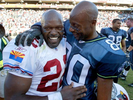 "Emmitt Smith and Jerry Rice embracing each other after a game in anything other than a Cowboys and 49ers uniform, respectively? Seems like something out of ""The Twilight Zone"", and it sets the stage for these other awkward images of NFL greats on teams they just don't belong on."