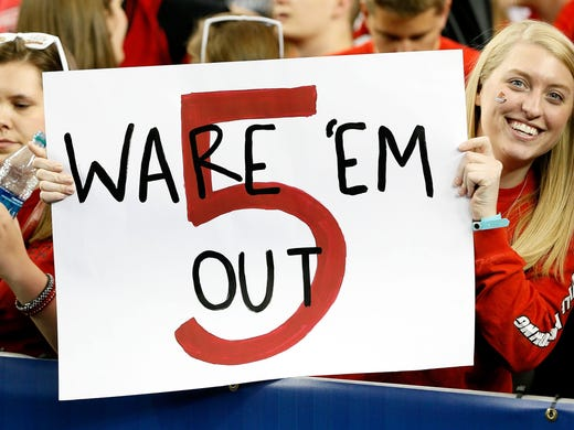 Louisville Cardinals fans hold up a sign for injured player Kevin Ware of the Cardinals before taking on the Wichita State Shockers the Final Four.