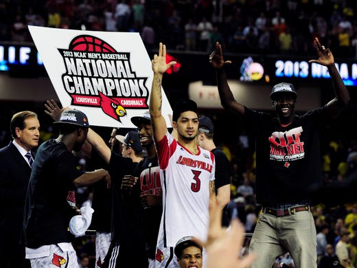The Louisville Cardinals defeated the Michigan Wolverines, 82-76, to win the national championship.