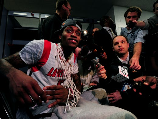 Louisville Cardinals guard Kevin Ware is interviewed in the locker room after Louisville won the championship game against the Michigan Wolverines at the Georgia Dome.
