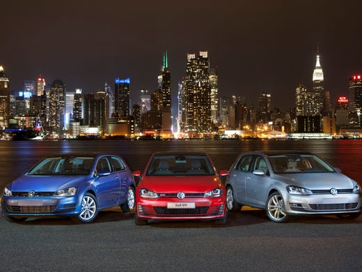The redesigned, seventh-generation 2015 Golf for the U.S. was unveiled at the New York Auto Show last month and models are shown here -- with the sporty GTI in the center -- against the New York skyline.
