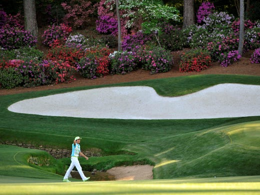 Rickie Fowler walks to the 13th green during the second round.