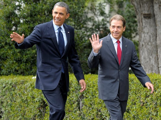 President Barack Obama walks with Alabama Crimson Tide head football coach Nick Saban to the South Lawn of the White House in Washington, Monday, April 15, 2013, where the president held a ceremony to honor the BCS National Champion University of Alabama Crimson Tide football team for their 15th championship and their 2012-2013 season.