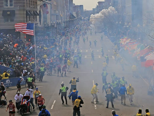 A second explosion goes off near the finish line of the Boston Marathon on April 15, 2013, in Boston.