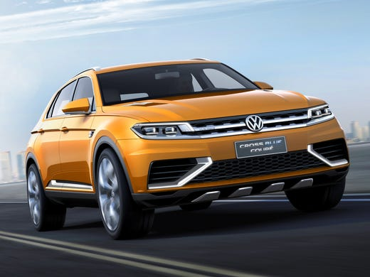 Volkswagen's CrossBlue concept, unveiled at the Shanghai auto show, blends elements of a car and SUV, and may foreshadow the look of a new midsize or larger SUV for VW.