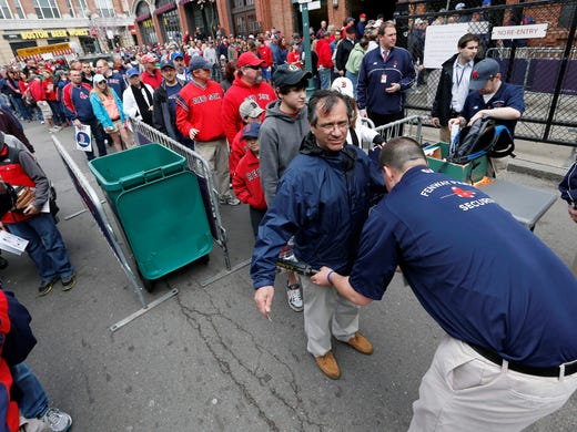 Fans pass through security before entering Fenway Park for a game between the Boston Red Sox and the Kansas City Royals Saturday, April 20.
