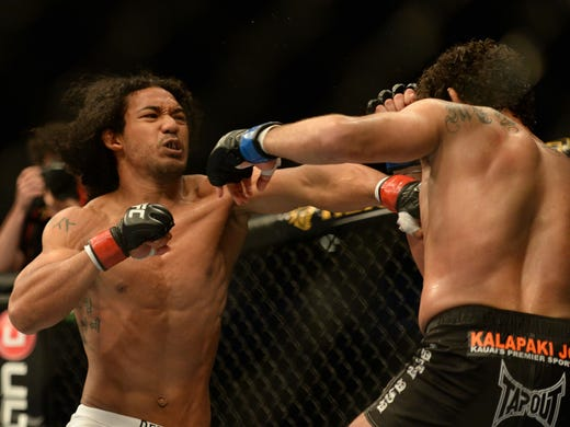 Benson Henderson (left) fights Gilbert Melendez (right) during the lightweight championship bout of the UFC on Fuel TV at HP Pavilion.