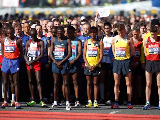 Runners observe a moment of silence in memory of Boston Marathon victims before the start during the London Marathon on Sunday.