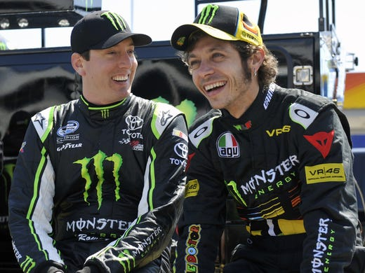 NASCAR driver Kyle Busch (left) and Moto GP rider Valentino Rossi share a laugh at Charlotte Motor Speedway, where they shot a video for Monster Energy.