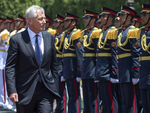 Secretary of Defense Chuck Hagel inspects Egyptian troops during an arrival ceremony at the Ministry of Defense on April 24 in Cairo.