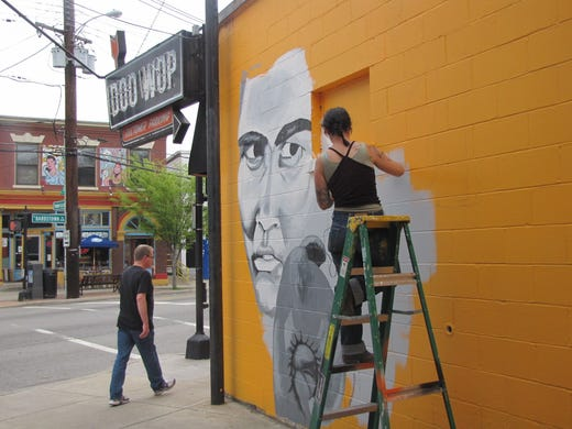 Artist Margaret Morley starts work on a 'Kentucky Rushmore' mural at the Why Louisville shop on Bardstown Road.