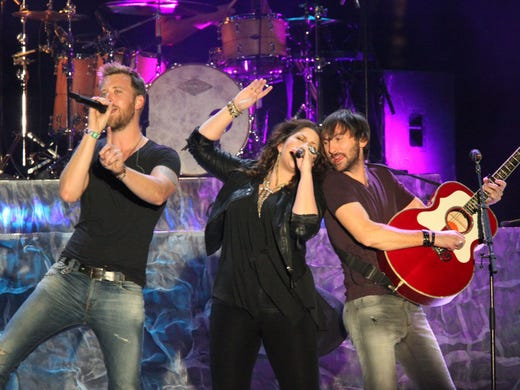 Lady Antebellum members Charles Kelly, left, Hillary Scott and David Haywood perform on the Mane Stage at the Stagecoach music festival  April 27 in Indio, Calif.