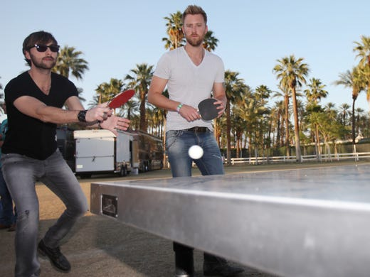 The band that plays together, stays together. Dave Haywood, left, and Charles Kelley of Lady Antebellum team up for a ping-pong doubles match before their performance at the Stagecoach country music festival on Saturday in Indio, Calif.