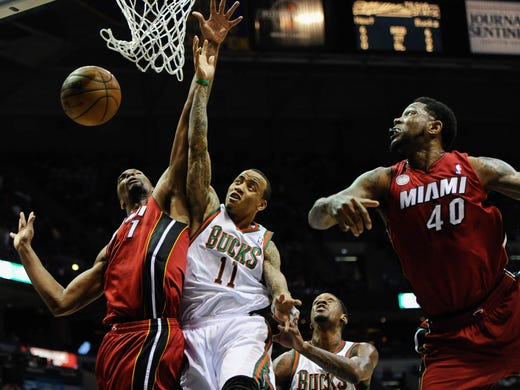 Game 4 in Milwaukee: Heat 88, Bucks 77 - Heat center Chris Bosh, left, boxes out Bucks guard Monta Ellis for a rebound while Heat forward Udonis Haslem, right, crashes the boards.