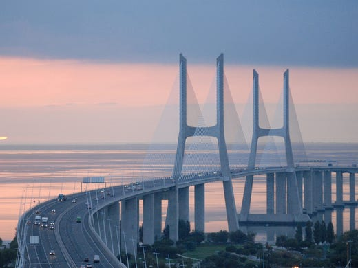 Vasco da Gama Bridge, Portugal - 56,381 feet: Lisbon's Vasco da Gama Bridge is the longest in Europe, spanning a total distance of 10.7 miles. Taking three years to complete, the bridge opened for traffic in 1998 to celebrate the 500th anniversary of Vasco da Gama's discovery of the maritime route from Europe to India. Designed to withstand 155 mph winds and earthquakes over four times stronger than the strongest ever to hit Lisbon, the bridge is expected to carry traffic for 120 years.