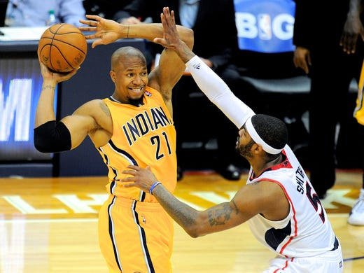 Game 6 in Atlanta: Pacers 81, Hawks 73 - David West looks to pass as Josh Smith defends.