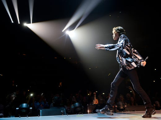 Mick Jagger works the crowd during 'It's Only Rock 'n Roll (but I Like It)' as The Rolling Stones officially kicked off their 50th anniversary tour on May 3 at the Staples Center in Los Angeles.