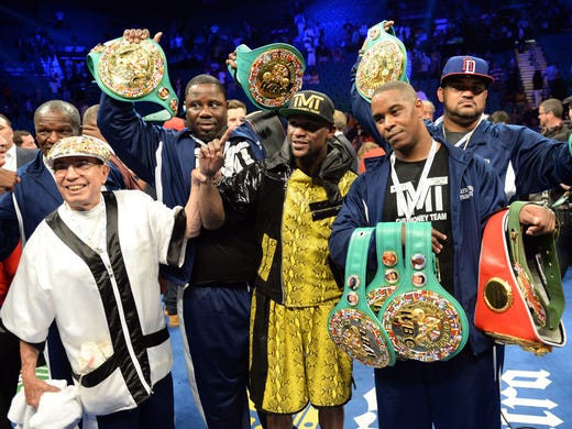 Floyd Mayweather holds his championship belts after his WBC Welterweight title fight defeating Robert Guerrero at the MGM Grand Garden Arena.