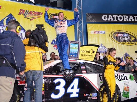 Talladega, AL, USA; NASCAR Sprint Cup Series driver David Ragan (34) celebrates after winning the Aaron's 499 at Talladega Superspeedway.