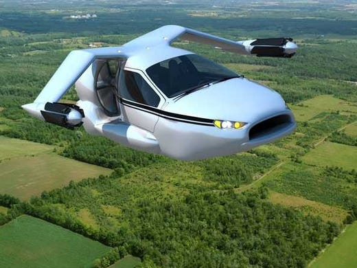 Terrafugia is showing off a concept of a flying car called the TF-X, which wouldn't be expected to be ready for deliveries for another decade. As seen in these artist renderings, it would take off like a helicopter and fly like a plane, but could driven on roads like a car as well.