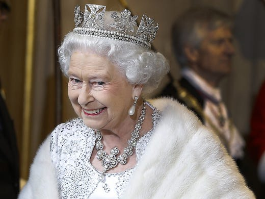 Queen Elizabeth II leaves the State Opening of Parliament event at the House of Lords on May 8 in London. The queen unveiled the coalition government's legislative program in a speech delivered to Members of Parliament and Peers in The House of Lords.