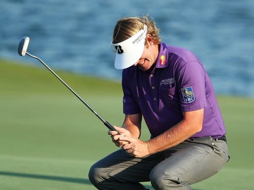 Brandt Snedeker of the USA reacts after playing a shot on the 18th hole