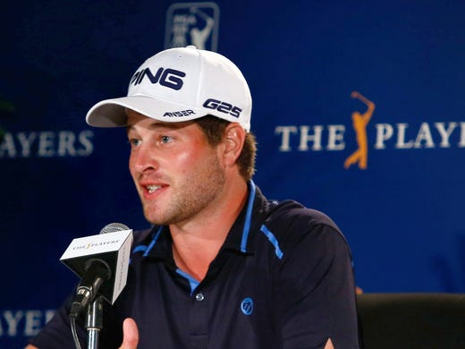 David Lingmerth speaks with reporters after play was suspended in the third round. He was at 12 under par for the tournament and leads by two shots..
