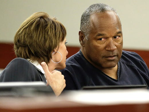O.J. Simpson talks with his attorney Patricia Palm during his retrial in Clark County District Court on May 13 in Las Vegas. Simpson seeks a new trial for a conviction in 2008 for robbery and kidnapping, claiming he had bad legal representation and his conviction should be reversed.
