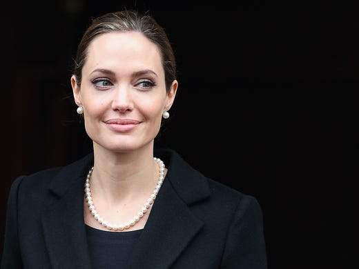 Angelina Jolie revealed May 14 in a 'New York Times' op-ed that she had a preventive double mastectomy after discovering that she carried the BRCA1 gene mutation, which sharply increases a woman's risk of developing breast cancer and ovarian cancer.<br />The Oscar winner, aspecial envoy for the United Nations High Commissioner for Refugees, leaves Lancaster House after attending the G8 Foreign Minsters' Conference on April 11 in London.