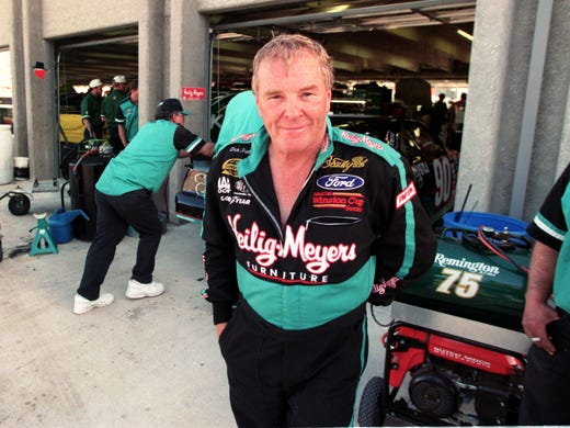 Dick Trickle, standing in the garage prior to the inaugural NASCAR race at Texas Motor Speedway on April 5, 1997, died of an apparent suicide on May 16, 2013.