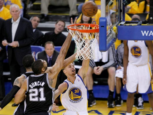 Game 6 in Oakland: Spurs 94, Warriors 82 - Stephen Curry puts a layup off the backboard.