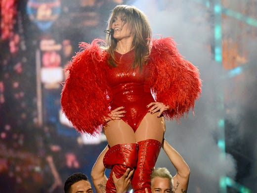 Jennifer Lopez gets a lift from her dancers while performing 'Live It Up.'