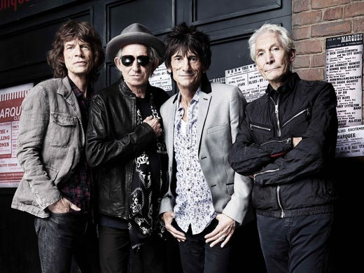 A new Rolling Stones retrospective opens May 24 at the Rock and Roll Hall of Fame and Museum in Cleveland. 'Rolling Stones: 50 Years of Satisfaction' showcases instruments, costumes, documents and other artifacts from the lengthy career of Mick Jagger, left, Keith Richards, Ronnie Wood and Charlie Watts.