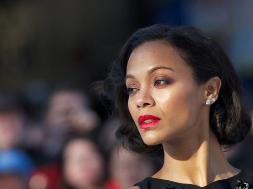 A-lister Zoe Saldana has traveled the world in recent weeks promoting both 'Star Trek Into Darkness' and 'Blood Ties,' which screened at the Cannes Film Festival. USA TODAY's Arienne Thompson has all the details on Saldana's chic looks.