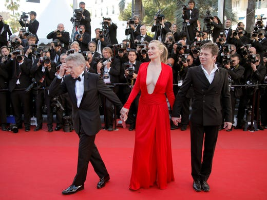 """Director Roman Polanski, left, arrives with actors Emmanuelle Seigner and Mathieu Amalric for the screening of Polanski's film """"Venus in Fur"""" at the 66th international film festival, in Cannes, France, Saturday, May 25, 2013."""