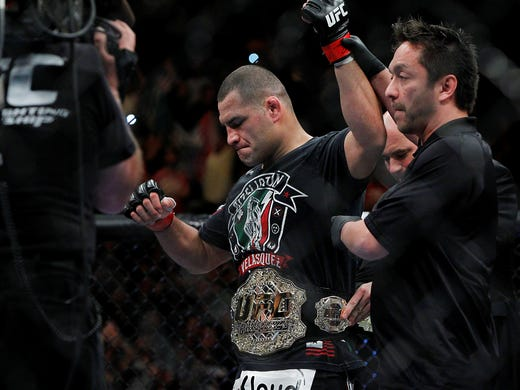 Cain Velasquez celebrates his victory against Antonio Silva following UFC 160 at the MGM Grand Garden Arena.