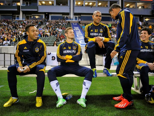 Los Angeles Galaxy midfielder Robbie Rogers (14) (center) with forward Charlie Rugg (27), defender Leonardo (22) and midfielder Jose Villarreal (33) before playing against the Seattle Sounders at Home Depot Center.