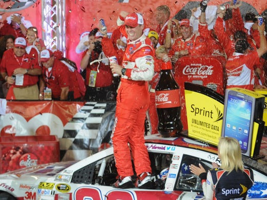 Kevin Harvick celebrates his victory in the Coca-Cola 600 at Charlotte Motor Speedway in Concord, N.C. In a bizarre race red-flagged three times, Harvick survived to win NASCAR's longest race for the second time in three years.
