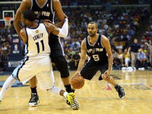 Game 4 in Memphis: Spurs 93, Grizzlies 86 - Memphis Grizzlies point guard Mike Conley (11) runs into a pick set by San Antonio Spurs power forward Tim Duncan (middle) as point guard Tony Parker (9) handles the ball.