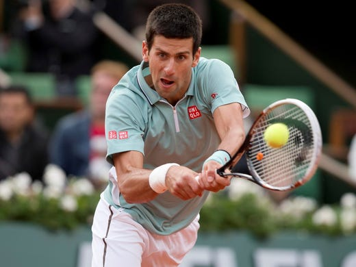 Novak Djokovic of Serbia lines up a backhand during his 7-6 (7-4), 6-4, 7-5 victory against David Goffin of Belgium.