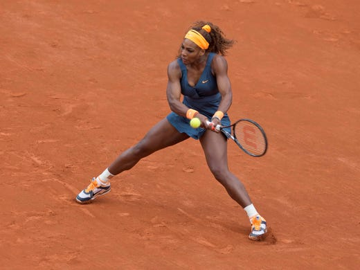 Serena Williams hits a backhand