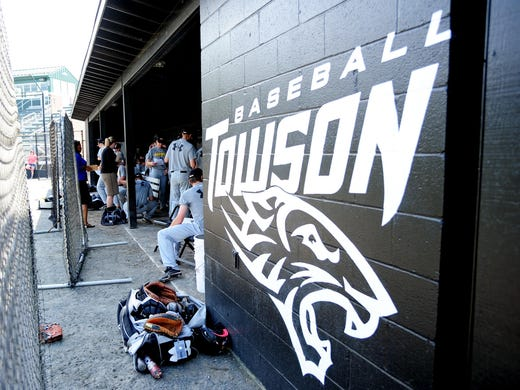 Towson Tigers players get ready for practice at John B. Schuerholz Park.