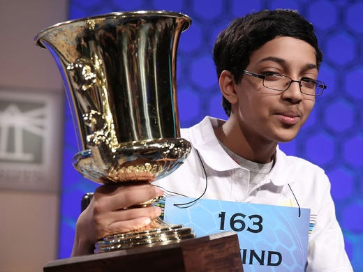 Arvind Mahankali of Bayside Hills, New York, holds his trophy after winning the spelling bee.